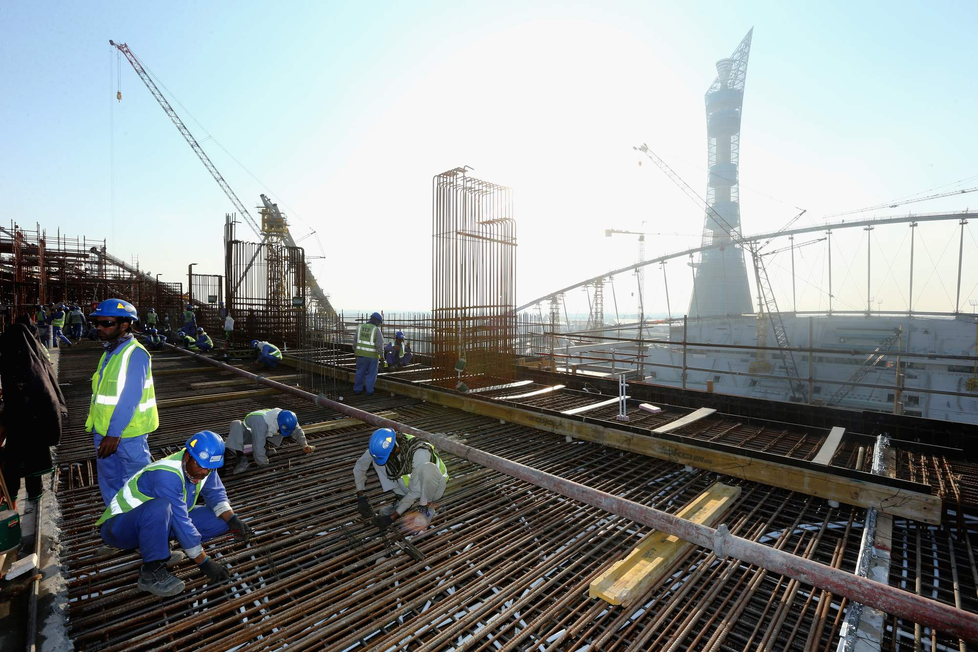 As construction continues at 2022 FIFA World Cup stadiums in Qatar, Amnesty International is campaigning to improve migrant workers' rights. Photo: Getty Images.